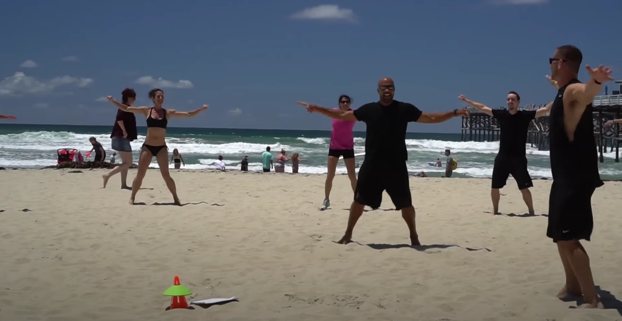 Group of people doing exercises on the beach