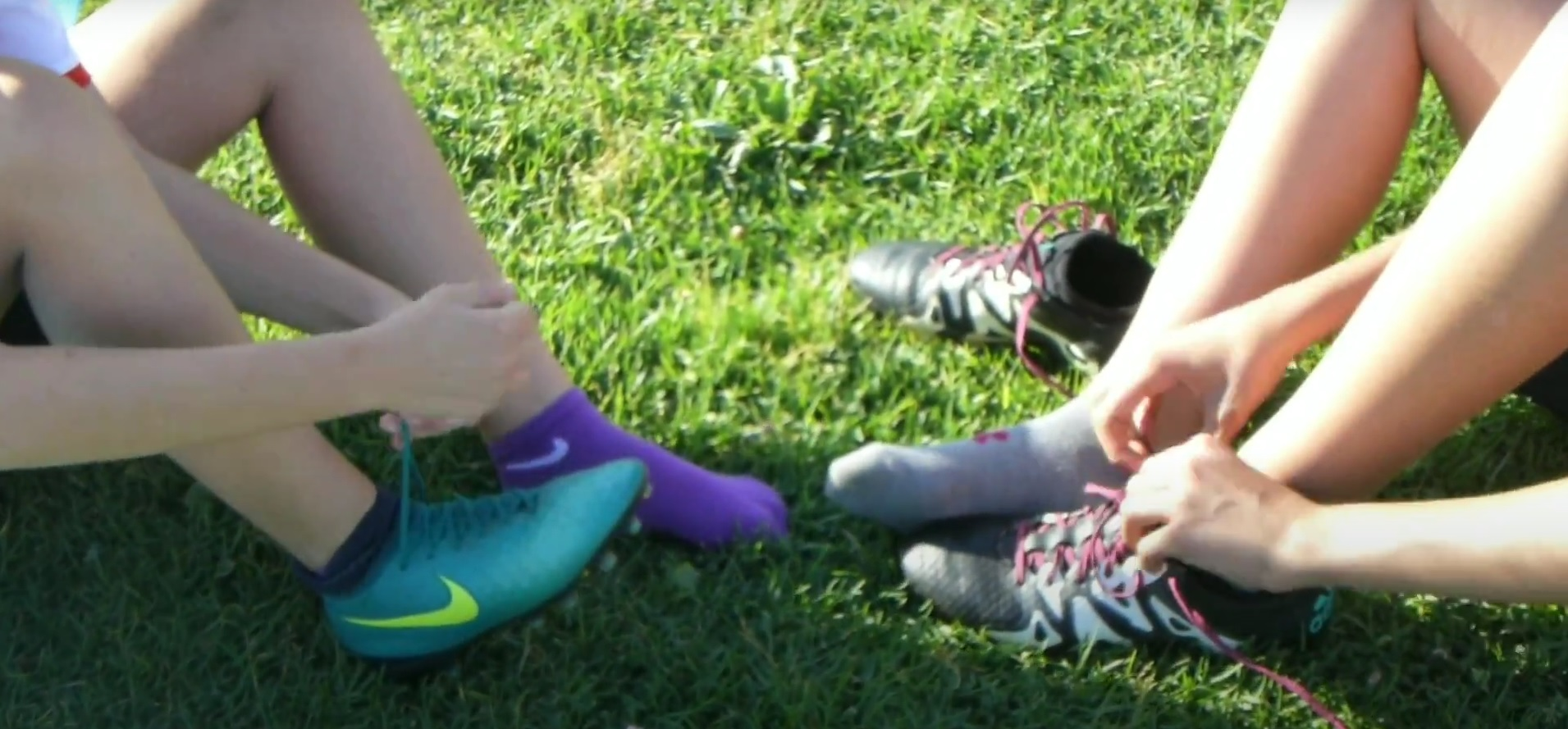 a picture of two kids tying their shoes