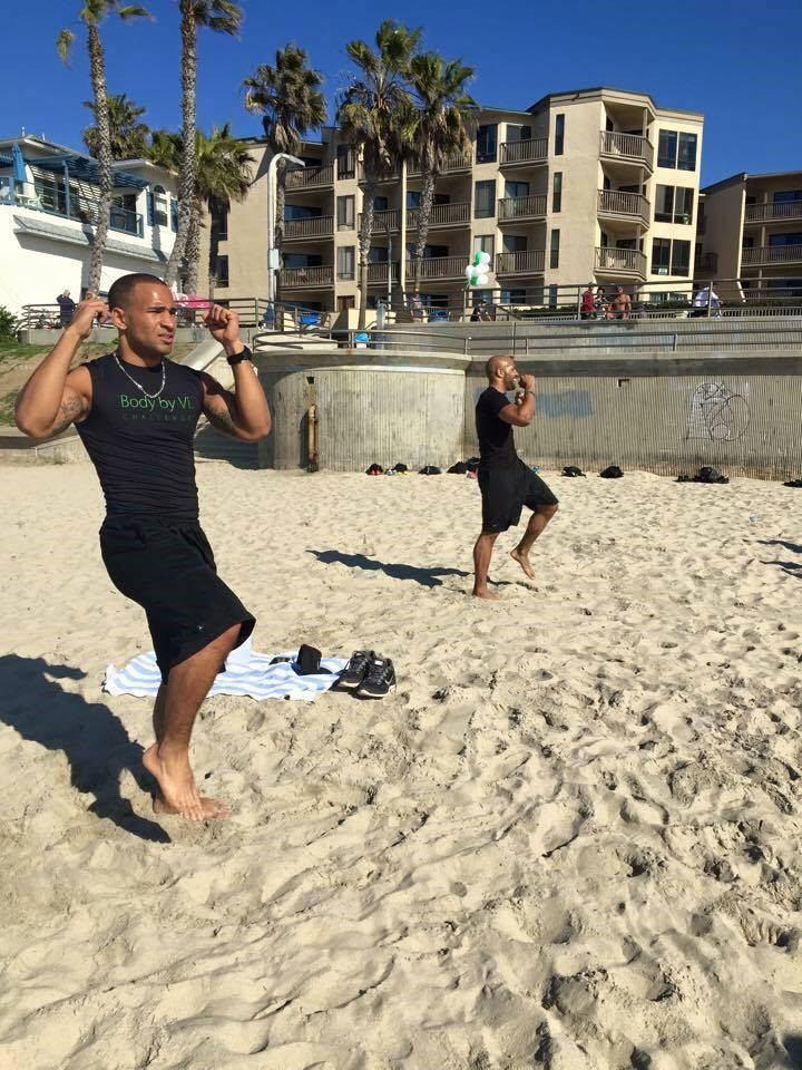 two men doing a beach exercise